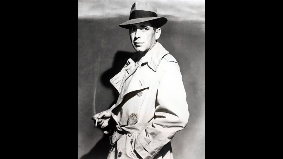 The trench coat has had a long association with stars of the silver screen – perhaps the most iconic being Humphrey Bogart.  (Pictorial Press Ltd/Alamy)