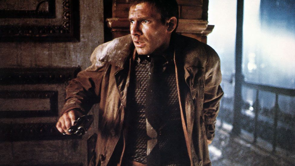 Harrison Ford fashioned the trench playing a replicant bounty-hunter in the futuristic sci-fi classic, Bladerunner. (Pictorial Press Ltd/Alamy)