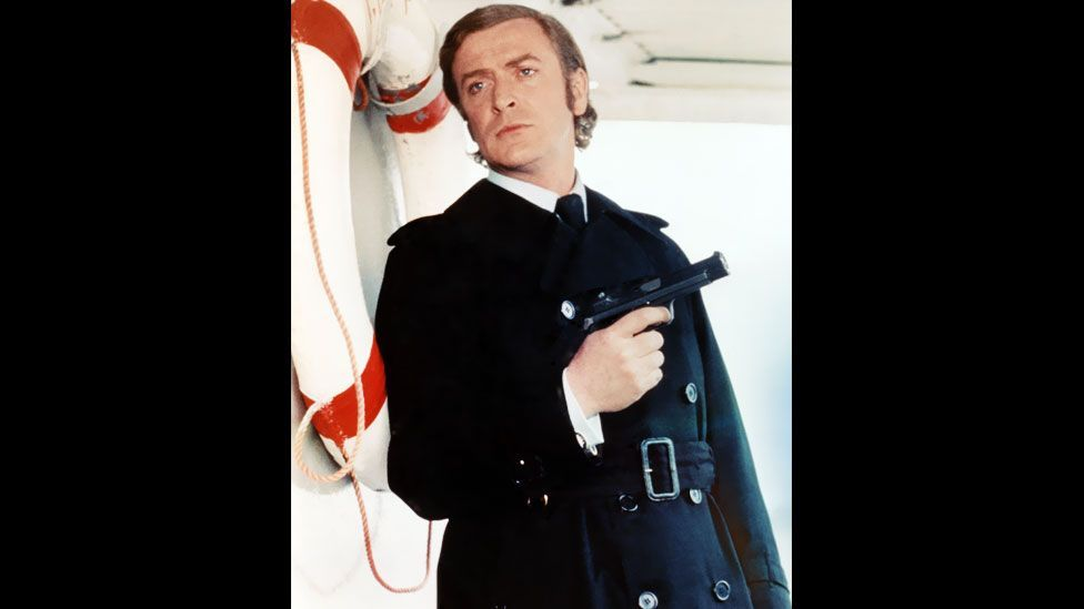 Michael Caine highlighted the trench's underworld connotations, playing a gangster in the 1971 movie, Get Carter.  (Pictorial Press Ltd/Alamy)