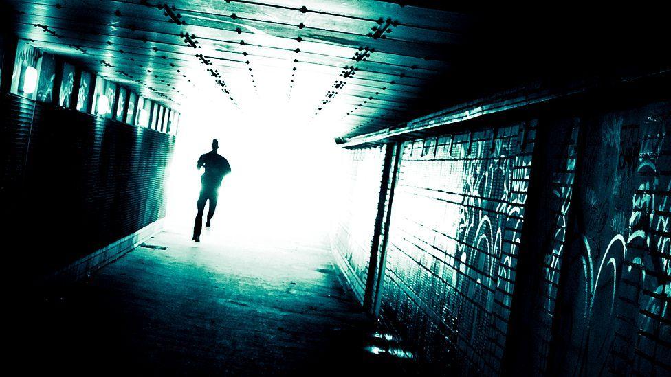 Man walking in tunnel (Stig Nygaard/Flickr)