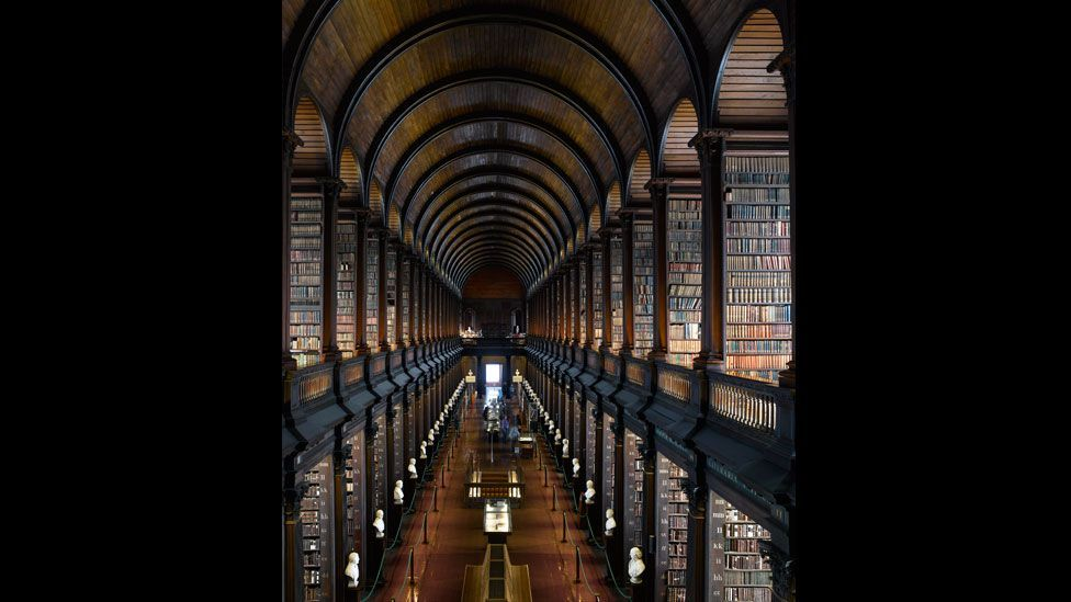The Long Room of Trinity College Library in Dublin houses the collection's oldest books and is lined with marble busts of great writers, philosophers and patrons of the college.