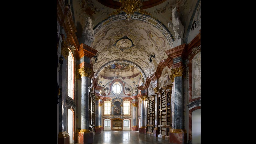 The highly ornamented library of Altenburg Abbey in lower Austria is the work of the Baroque architect Joseph Muggenast and is decorated with frescoes by Paul Troger.