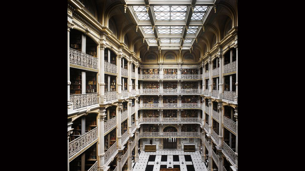 A skylight soars over five cast-iron ornamental balconies in the George Peabody Library at Johns Hopkins University in Baltimore.