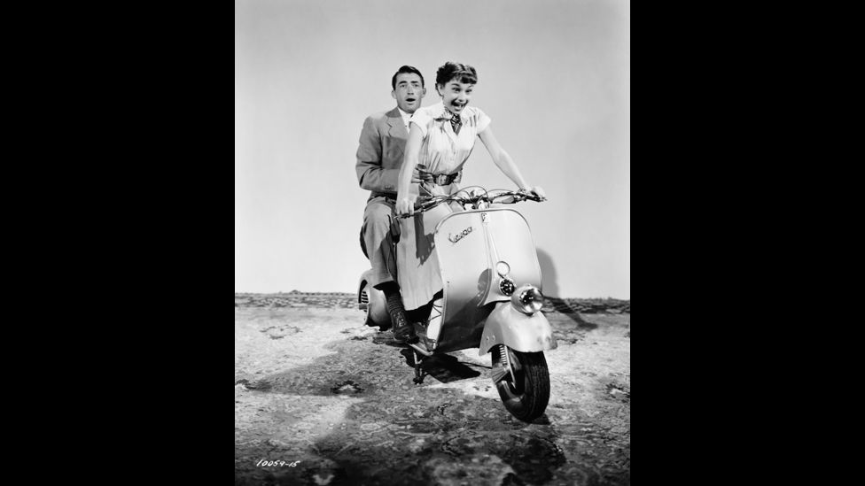 The iconic sequence of Audrey Hepburn and Gregory Peck puttering around Rome on a Vespa in 1953's Roman Holiday was said to be worth 100,000 sales. (Corbis)