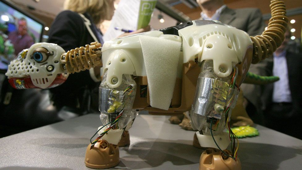 If Pleo didn't have its soft skin, might it be easier to see the bot as the machine it is? (John MacDougall /AFP/Getty)