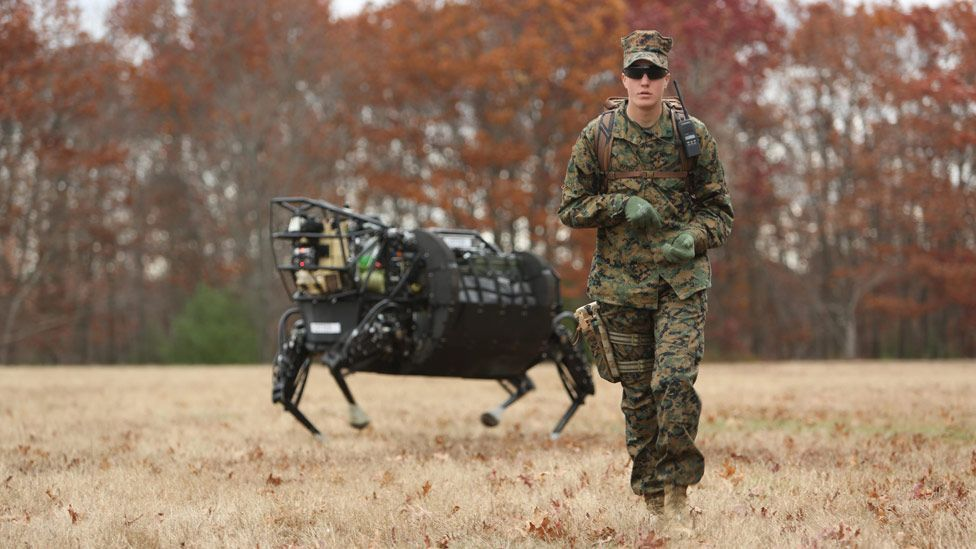 Soldiers give medals and hold funerals for their robot helpers, such as this bot that carries heavy loads. (USMC/Kyle J. O. Olson)