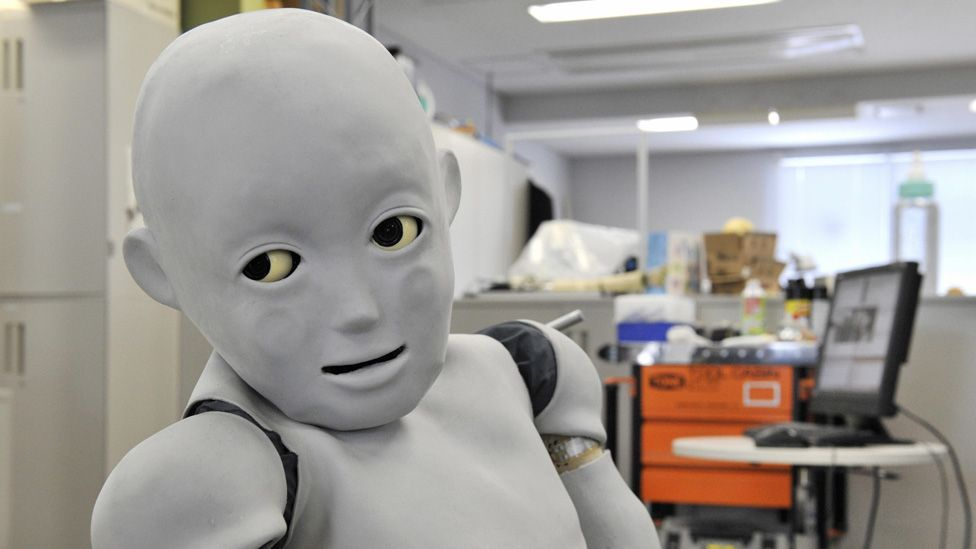 This robot built in Japan has a child-like body and soft skin. Its creator is programming it to think like a baby. (Yoshikazu Tsuno/AFP/Getty)