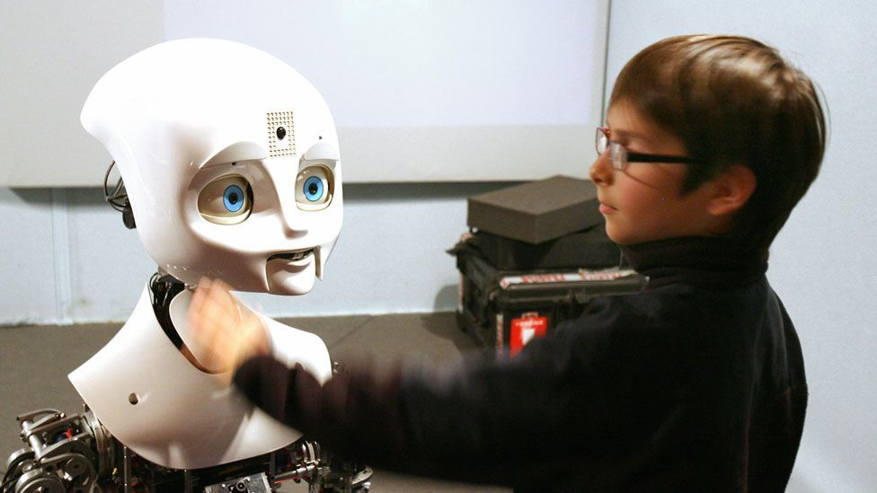 This robot called Nexi smiles at people when they approach. (Thomas Bregardis/AFP/Getty)