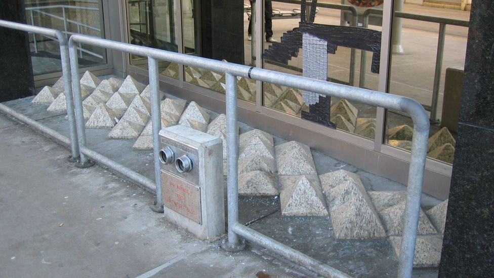 Decorative blocks placed in this window in Canada also prevent people from sitting or sleeping there. (Marian Doerk)