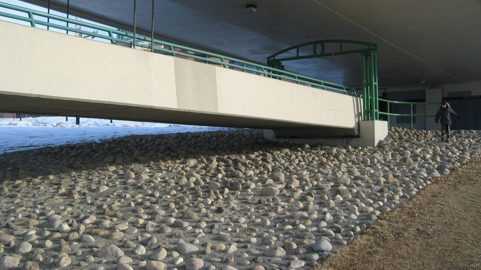 Uneven boulders were added to the space under this bridge in Calgary, Canada to force out the homeless sheltering there. (Marian Doerk)