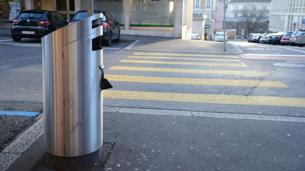 The opening to these bins in Switzerland is deliberately small to discourage large items. (Selena Savic)