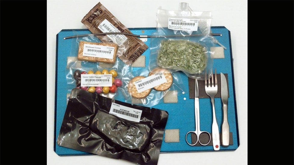 Velcro is vital for the Christmas meal, it keeps the food and utensils on astronauts' trays. (Nasa)