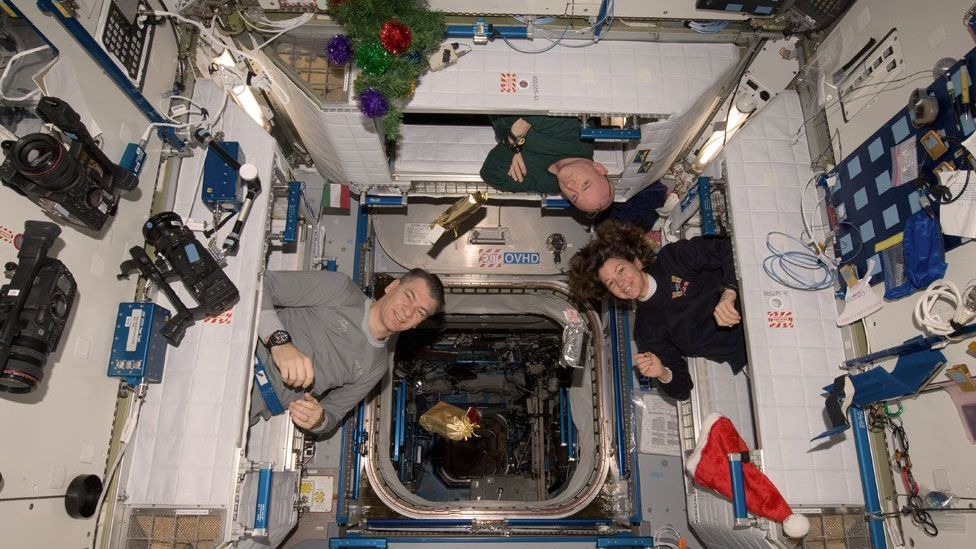 On the Christmas morning Paolo Nespoli (left) was on the ISS, the crew were surprised with presents. (Nasa)