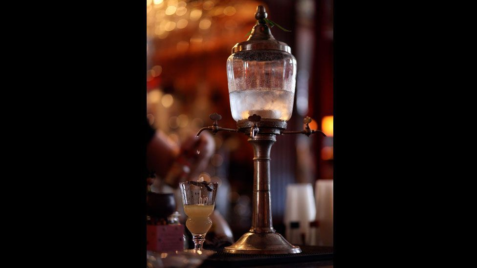 The drink was often prepared in a fountain – or poured over sugar cubes suspended above a cup on a spoon – to dilute its bitter taste. (Wikimedia Commons)