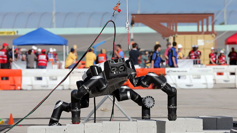 RoboSimian, from the Nasa Jet Propulsion Laboratory, tackles a wall-climbing challenge at the Homestead-Miami Speedway, as part of a multinational robotics competition. (AP)