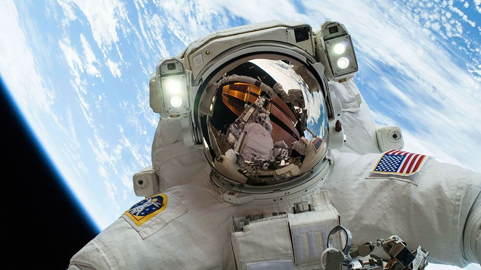 Astronaut Mike Hopkins is pictured while carrying out the second of his two spacewalks – with photographer and fellow astronaut Rick Mastracchio seen in his visor. (Nasa/Reuters)