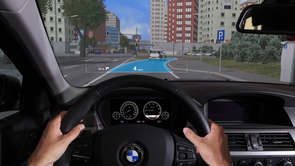 BMW has also been working on an augmented display which includes information from the navigation system, showing which route to take. (BMW)
