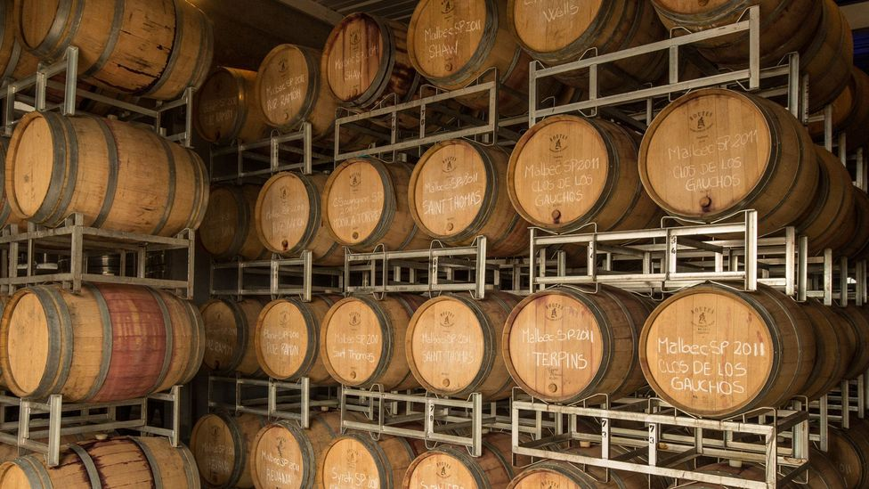 Wine marked with owners' names ages in barrels at the vineyard. (Michael Evans)