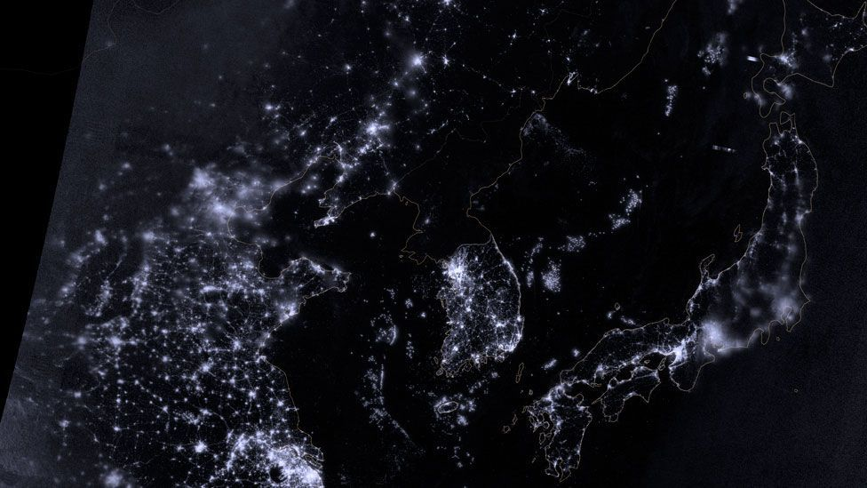The people of North Korea have less access to modern technology than their neighbours, as this night-time satellite image hints. (Nasa)