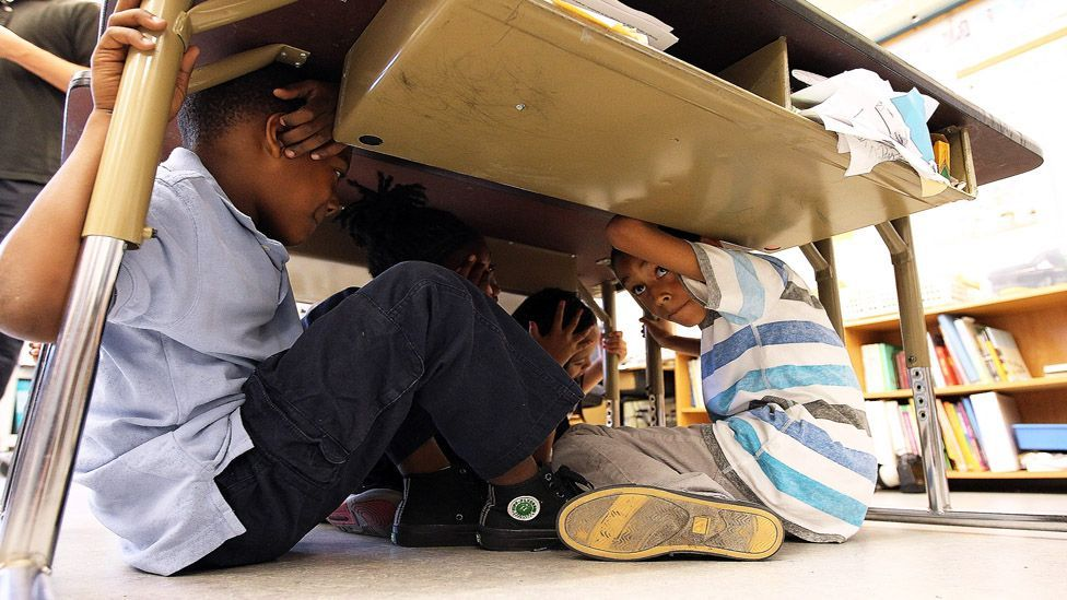 School children take cover under desks during an earthquake drill in San Francisco, California. (Getty)