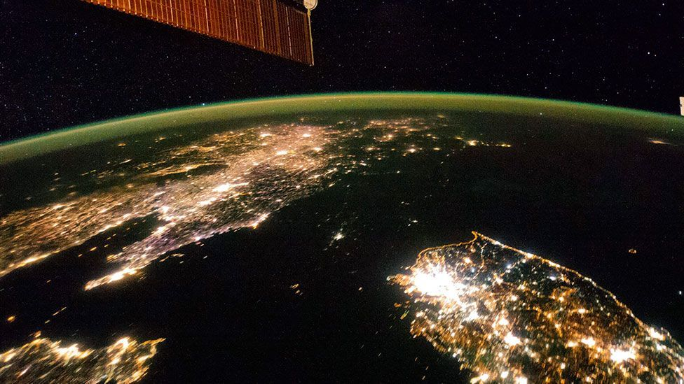 An almost completely dark North Korea seen in a night-time image taken from the ISS, in stark contrast to the blazing lights of nearby South Korea and China. (Nasa-JSC/Reuters)