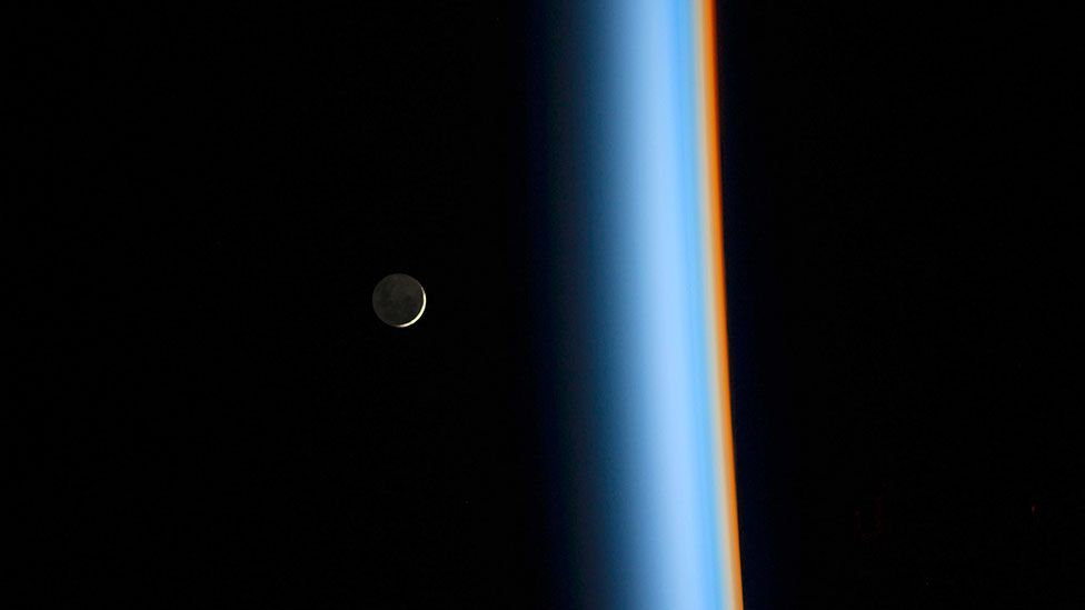A crescent moon rises over the Earth in an image taken by Japanese astronaut Koichi Wakata onboard the International Space Station (ISS). (Nasa/Reuters)