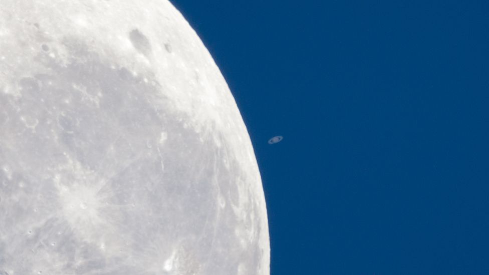 Saturn seems tiny next to our Moon as it passes in front of the planet – an event known as an occultation. (Colin Legg)