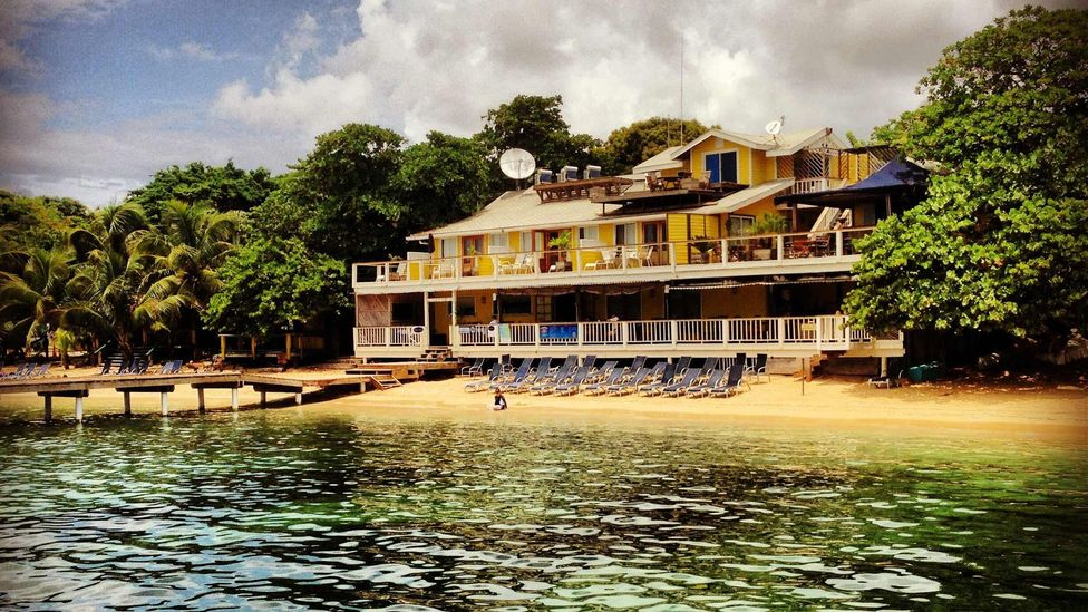 Kate Warburton bought a four-room guesthouse on an island near Honduras and is expanding to eight rooms. (Beach House Roatan)