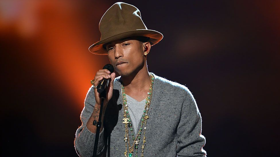 Performing on stage at the Grammys earlier this year, Williams wore his famous Vivienne Westwood hat.  (Kevin Winter/Getty Images for NARAS)