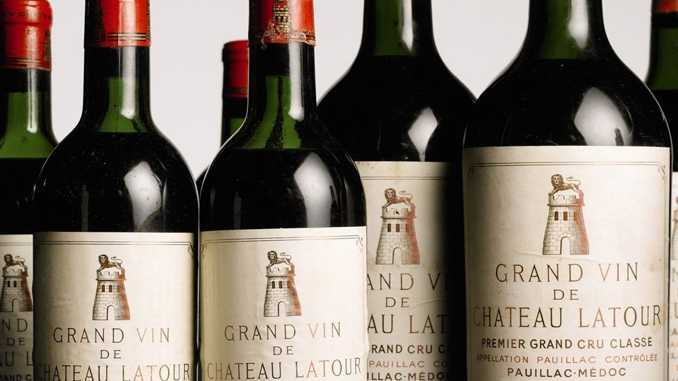 Prospective buyers can sense wine quality by seeing if there are any stains on the labels and examining the level of wine in the bottle. (Christie's Images Ltd)