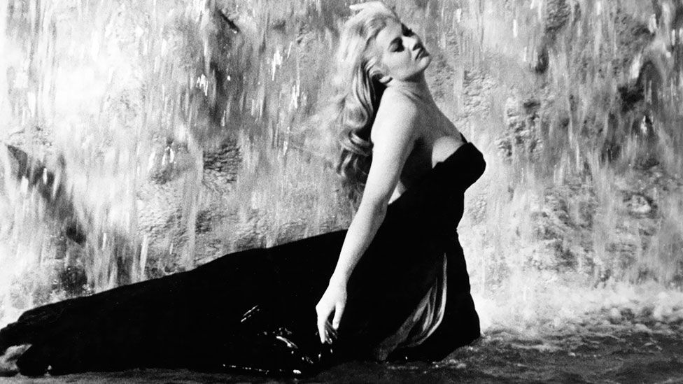 The scene in which Anita Ekberg  cavorts in Rome's Trevi Fountain in Fellini's 1960 film La Dolce Vita has become an iconic image of sybaritic Italian glamour. (AF archive/Alamy)