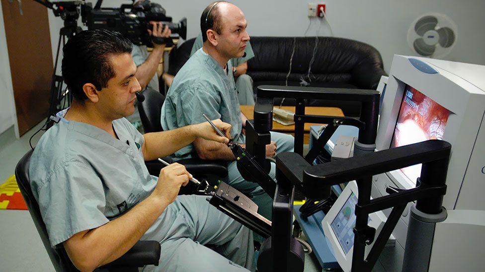 Mehran Anvari controls his robot surgeon, conducting a keyhole surgery (St Joseph's Healthcare)