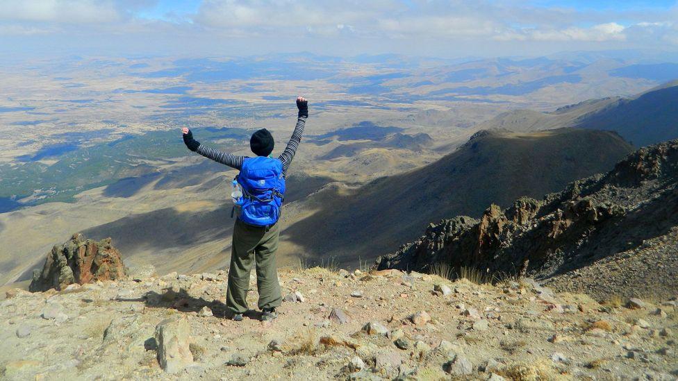 Standing on top of Mount Hasan's caldera ridge. (Jess Lee)