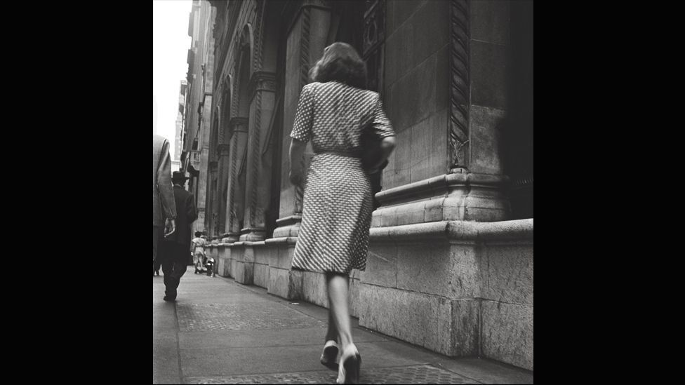 Street Conversations – Woman walking down the street, 1946