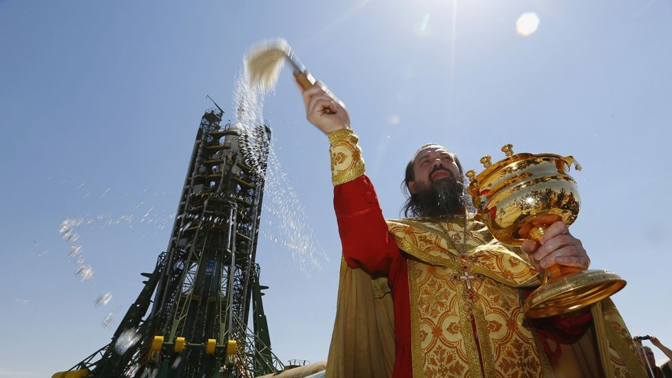 With Orthodox Christianity resurgent in Russia, rockets waiting on the launchpad are now given a blessing by a priest (AFP/Getty Images)