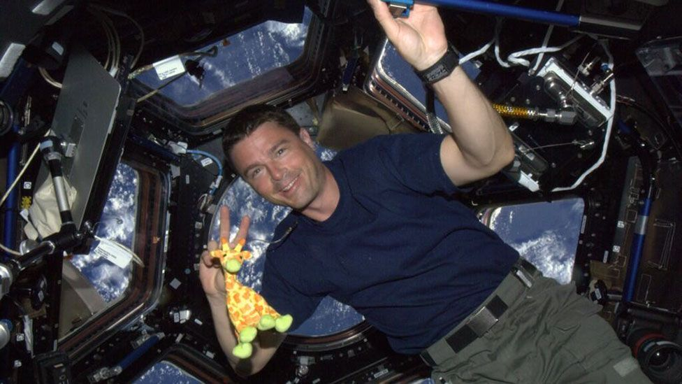 Reid Wiseman tweeted this picture of him and his toy giraffe mascot from the International Space Station (Reid Wiseman)