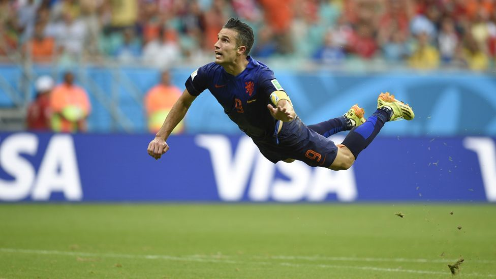 Are you exhibiting the same kind of skills Robin Van Persie shows on the pitch when you're driving your car? (AFP/Getty Images)