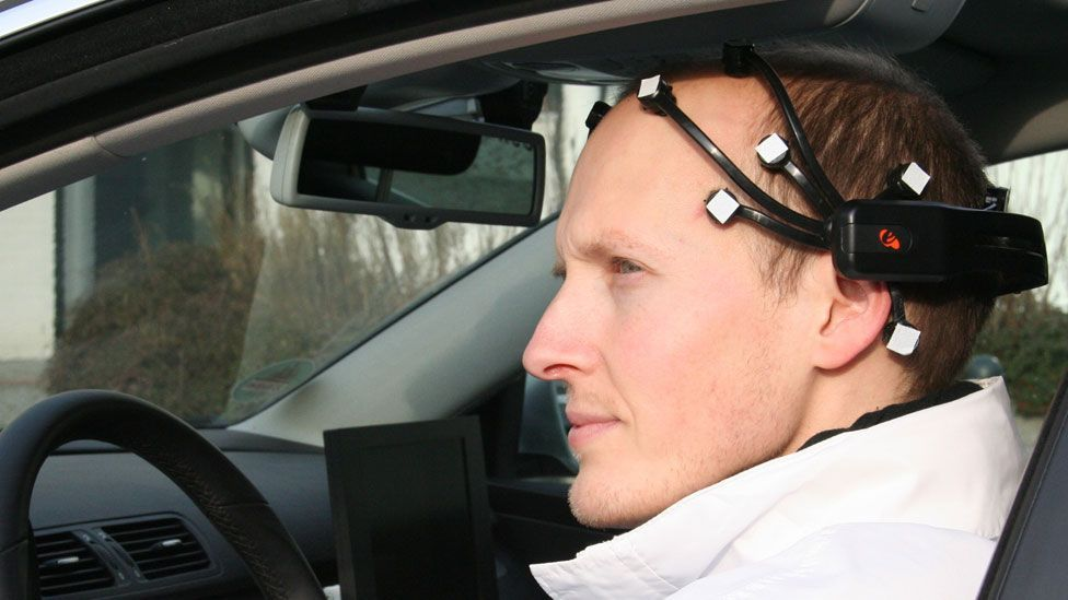 A member of the Brain Driver team wears the headset used to control their car (Brain Driver project)