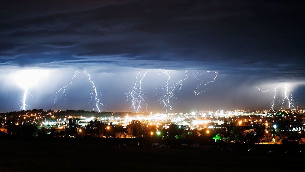 Lightning erupts from storm clouds over Gillette, Wyoming. Weather forecasters have predicted more heavy rain and thunderstorms. (Daniel Brenner, Gillette News Record/AP)
