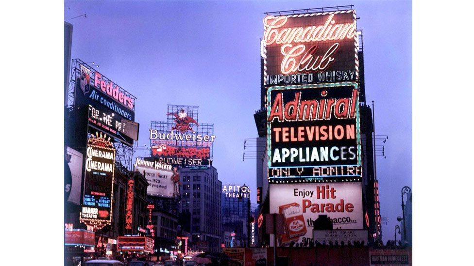Neon signs create iconic landmarks in city centres, such as New York's Times Square (Rex)