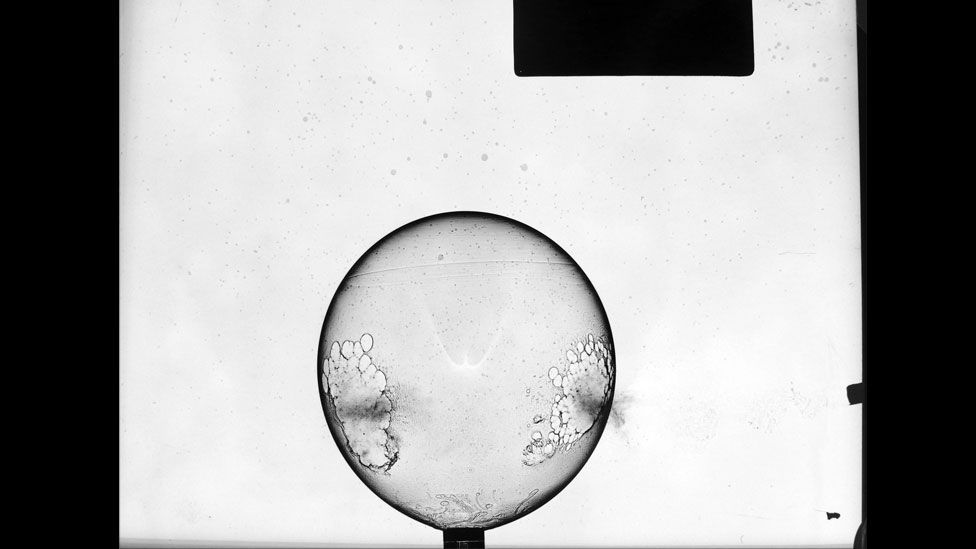 Here's a balloon punctured by a bullet, moments before it bursts. (Harold Edgerton Archive, MIT)
