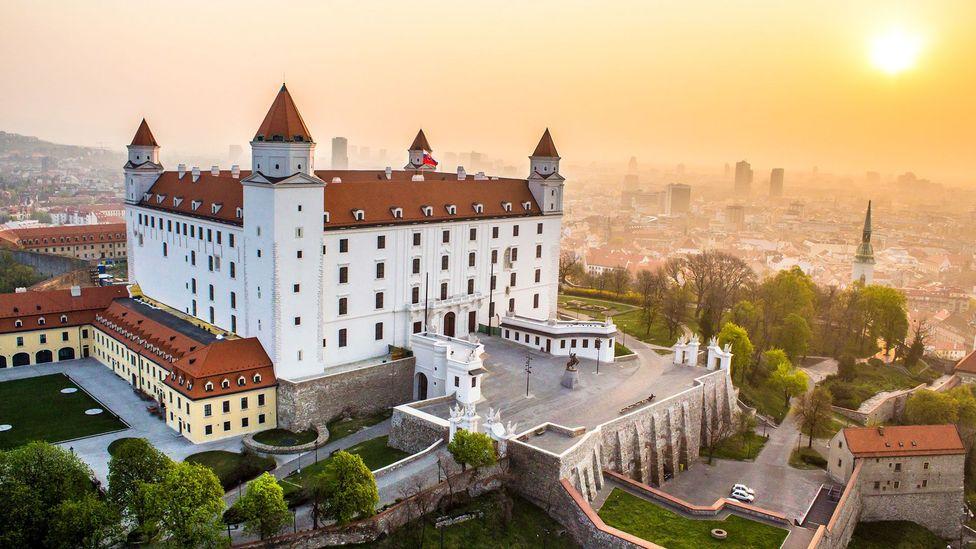 The sun rises on a castle in Bratislava