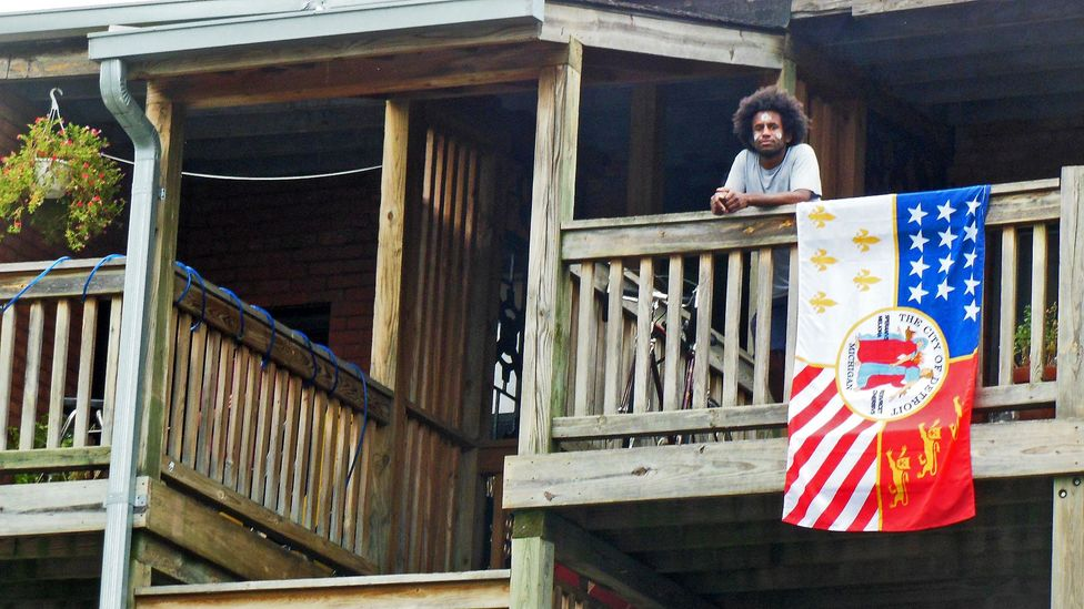 Local pride: a Detroit flag hangs over a balcony downtown. (Joe Baur)