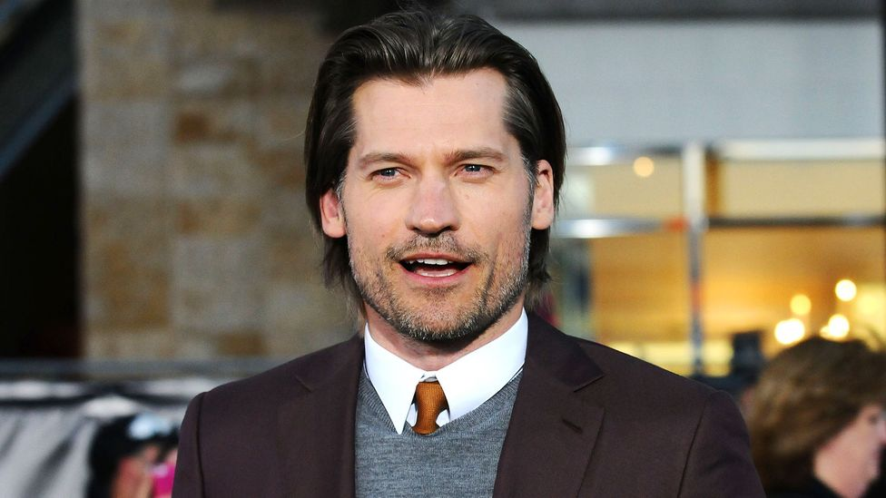 A brown tie, such as actor Nikolaj Coster-Waldau's, can come across as friendly. (Jason LaVeris/GettyImages)