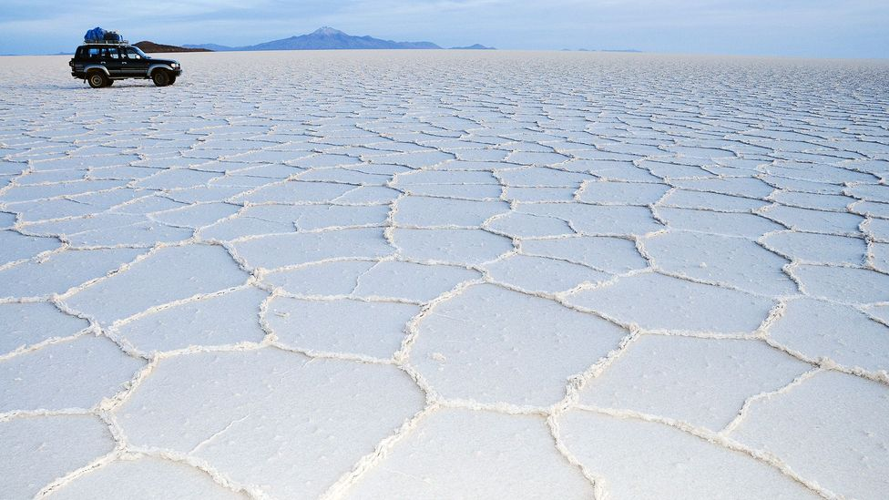 The sun rises over the Salar de Uyuni, the salt flats of southern Bolivia. (Audrey Scott)