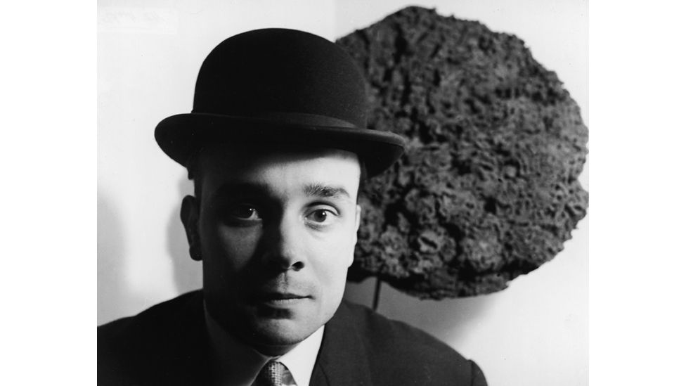 Klein photographed in front of one of his Blue Sponge Sculptures in the late 1950s (Express Newspapers/Getty Images)