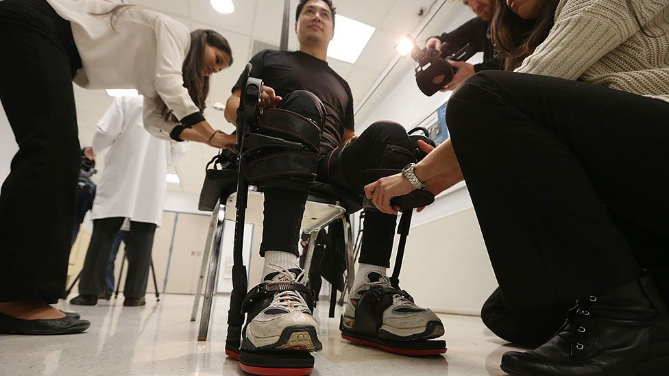 A man paralysed in a construction accident is outfitted with an exoskeleton made by Ekso Bionics (Mario Tama/Getty Images)