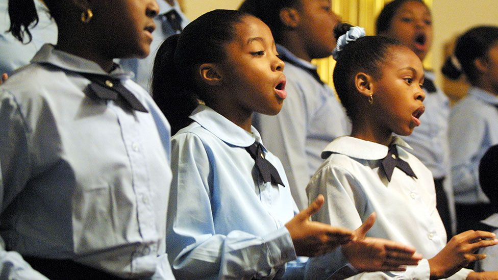 Children sing at St John Baptist Church in New York, in honour of the victims of 9/11 (Joe Raedle/Getty Images)