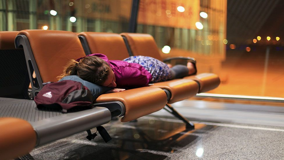 Sleeping on a row of seats might not endear you to your fellow travellers (Getty Images)