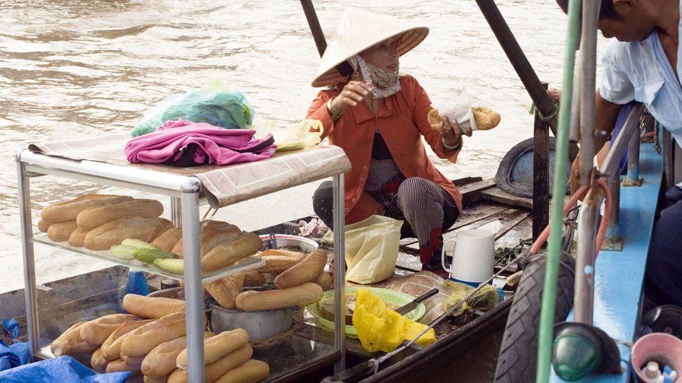A banh mi vendor on a boat in Vietnam. (Jupiter Images/Getty)